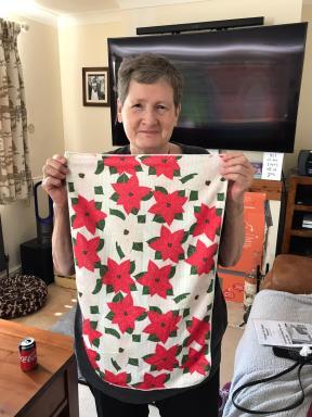 Catherine and her Poinsettia Tea Towel. On 'loan'.