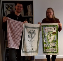 Some more happy faces getting 'new' tea towels but that red one certainly has some stains!