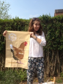 Jai looks excited with her new tea towel! The Hen: 2016. To read the story www.myteatowels.wordpress.com/2017/06/29/the-cockerel-and-the-hen-2008/
