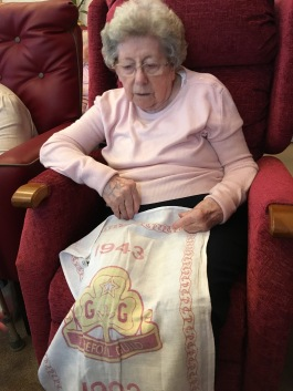 Jean reminiscing about the Trefoil Guild with one of her old tea towels