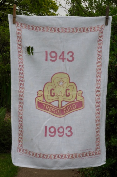 The 'real thing', bought in 1993, well worn and celebrating the Golden Jubilee of the Trefoil Guild. Love the hole in the tea towel